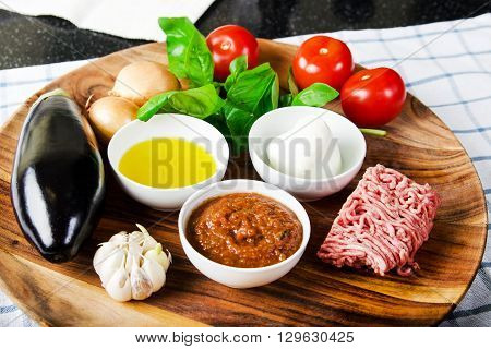 ingredients for cooking parmigiana di melanzane: baked eggplant - italy, sicily cousine. Stock image.