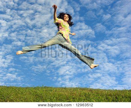 jump girl under cloud sky