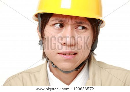 portrait of perplexed construction worker on white background poster