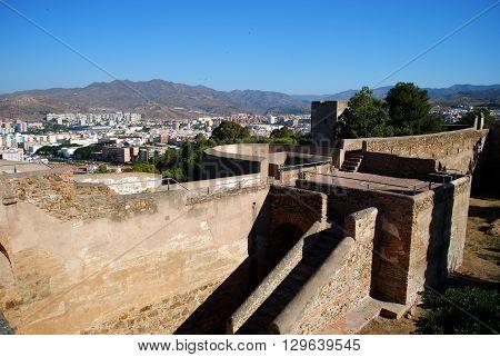 MALAGA, SPAIN - JULY 11, 2008 - Gibralfaro castle walls with views over the city Malaga Malaga Province Andalucia Spain Western Europe, July 11, 2008.
