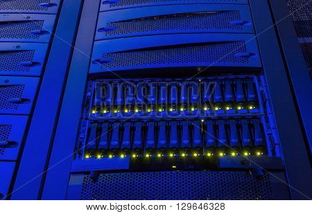 rack with blade behind bars mainframe in data center