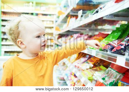 child making food shopping at grocery store