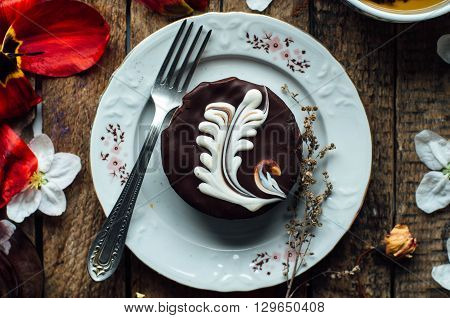 chocolate Sponge Cake.freshly baked brownie-type sponge cake with chocolate. sauce. photo of delicious chocolate cake on wooden table