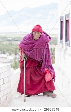 TIKSEY INDIA - SEPTEMBER 08 2014: Old unidentified Tibetan Buddhist monk in the monastery of Tiksey in Ladakh. Tiksey is the oldest and largest Buddhist monastery in Ladakh India