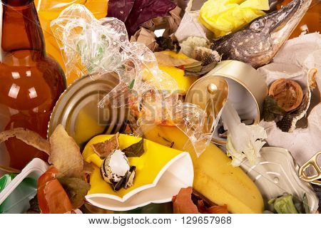 Tin can, banana peel, tray of eggs and other debris close up, texture
