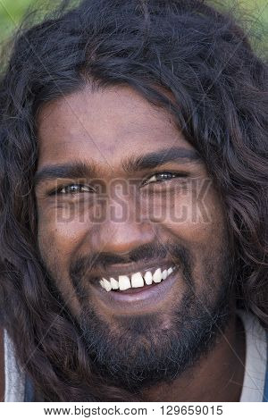 MIRISSA SRI LANKA - NOVEMBER 2 2014: Unidentified portrait of young local man smiling for camera. Local people in Sri Lanka are very friendly to tourists.