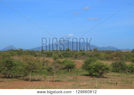 Central American savanna on background of extinct volcanoes poster