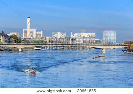 Basel, Switzerland - 31 October, 2014: view along the Rhine river. Basel is a city in northwestern Switzerland on the river Rhine it is Switzerland's third most populous city, after Zurich and Geneva.