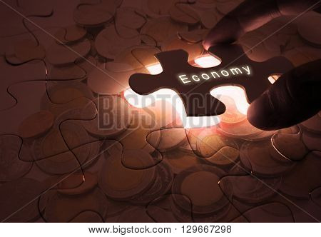 Economy Global Business with Puzzle Coins in the dark