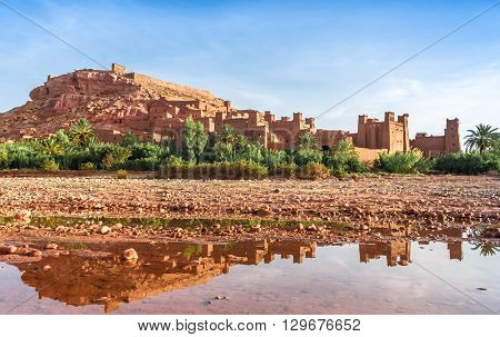 View of ksar Ait Benhaddou reflected in the water, Ait Ben Haddou Kasbah, Ouarzazate, Morocco