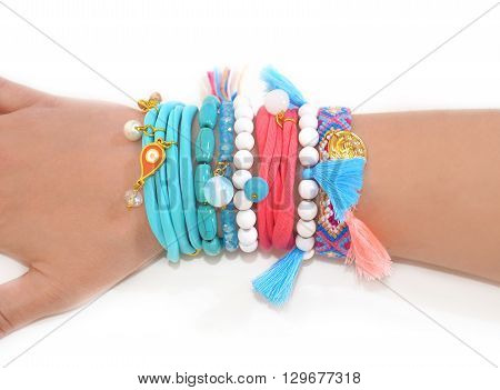hand wearing bohemian gypsy bracelets - advertise woman accessories