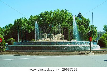 Neptune Fountain on Plaza de C0novas del Castillo on Paseo del Prado Madrid Spain Europe