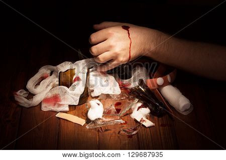 Man's hand with a bleeding wound of fragments of beer bottles