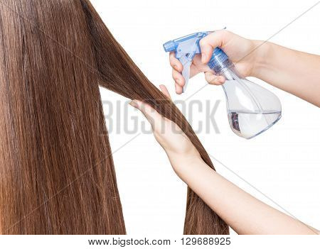 spraying long smooth hair isolated on white background
