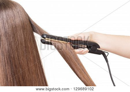 Hairdresser smoothes hair curling isolated on white background