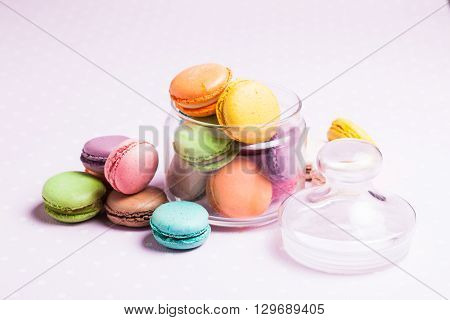 Colorful macaroons - french dessert in a glass jar