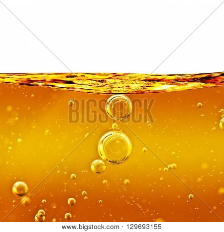 Oil background. Wave from yellow liquid with air bubbles.