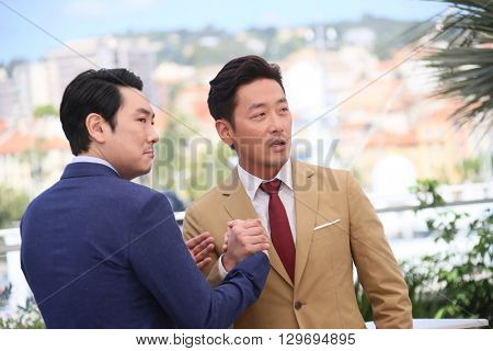 Actor Cho Jin-Woong, Ha Jung-Woo attend 'The Handmaiden (Mademoiselle)' photocall during the 69th annual Cannes Film Festival at the Palais des Festivals on May 14, 2016 in Cannes, France.