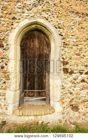 Old Wooden Church Door And Stone