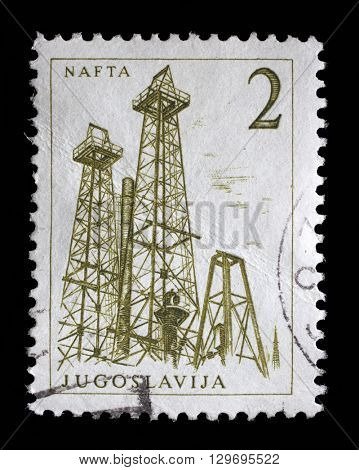 ZAGREB, CROATIA - JUNE 14: Stamp printed in Yugoslavia shows a Oil derricks, Nafta, with the same inscription, from series
