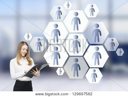 Lead generation concept with businesswoman next to staff icons