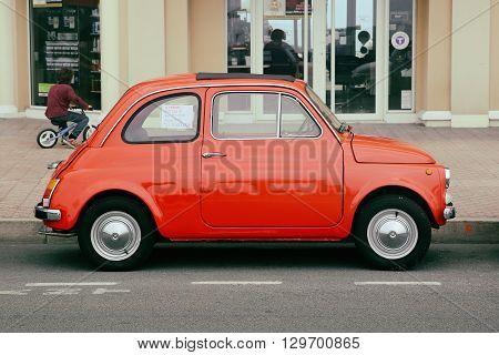 Menton France - May 14 2016: Small Italian car Fiat 500 Parked in a Parking Lot in Menton. Red Fiat 500 R