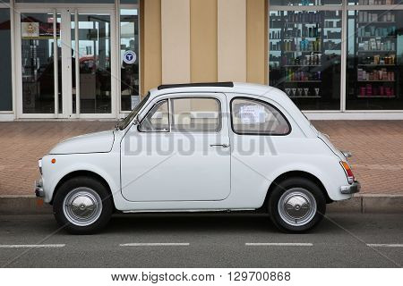 Menton France - May 14 2016: Small Italian car Fiat 500 Parked in a Parking Lot in Menton. Red Fiat 500 F