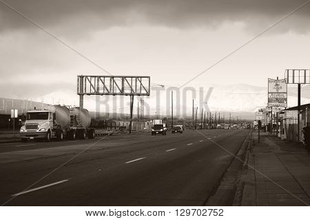 MOJAVE, UNITED STATES - DECEMBER 22: Road traffic with cars and trucks on the main road and next to the railway tracks on December 22 2015 in Mojave.