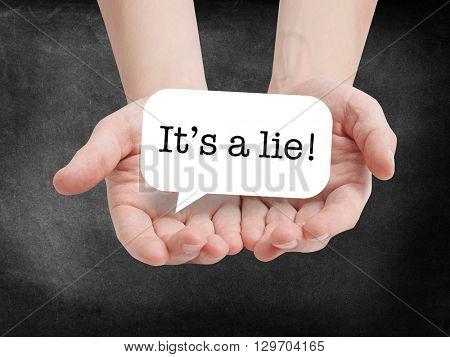 It's a lie written on a speechbubble