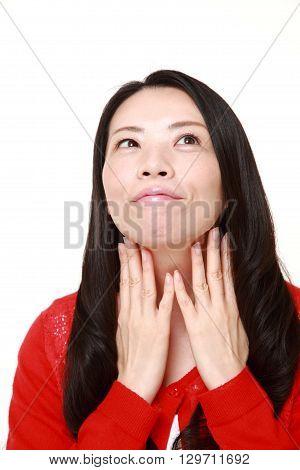 Japanese woman doing a self lymph node massage