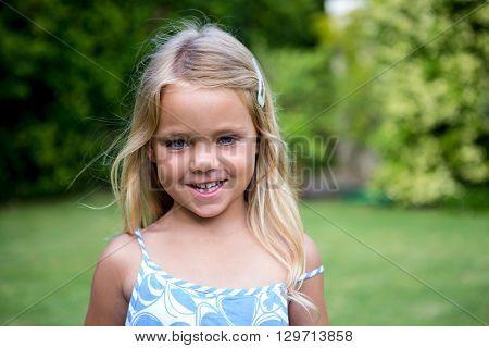 Portrait of cute smiling girl in back yard