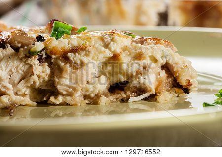 Slice Of Tart With Chicken Amd Mushrooms