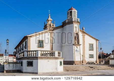 Nossa Senhora da Lapa church in Povoa de Varzim, Portugal. The place where the many local fishermen or families seek help in times of danger. It includes a lighthouse in the structure.