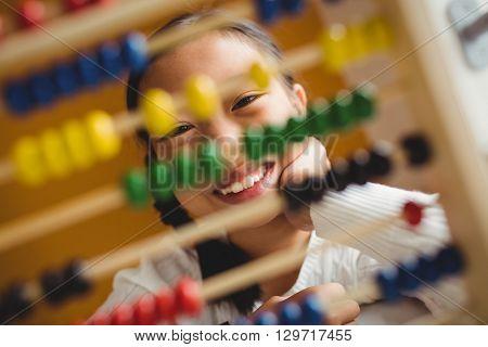 Schoolchild using a slide rule at school