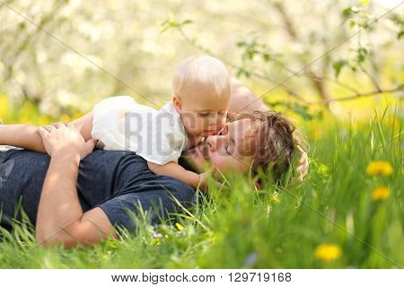Baby Girl Looking Lovingly At Father While Outside