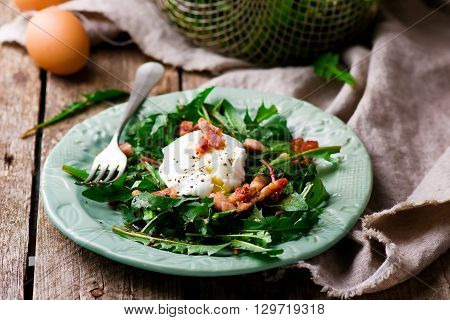 salad with dandelions and egg .selective focus
