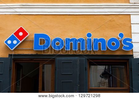 Bucharest, Romania, May 4, 2016: Domino's pizza logo. Domino's Pizza is an American restaurant chain and international franchise pizza delivery corporation headquartered in Michigan, United States.