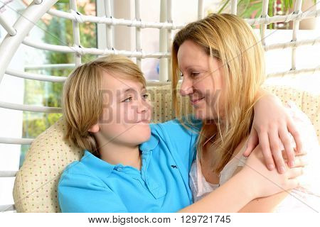 blond mother hugged her son at home