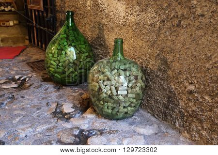 Saint-Paul de Vence ,France - May 22: It is standing near the wine cellar bottles with used wine corks attract more attention than advertising May 22, 2015 in Saint-Paul de Vence ,France.