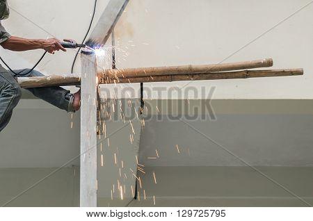 Arc Welder Cutting Steel Pipe With Acetylene Welding