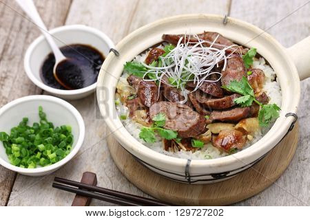 chinese sausage and chicken with rice in clay pot, cantonese food