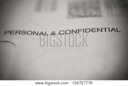 an envelope marked with personal & confidential