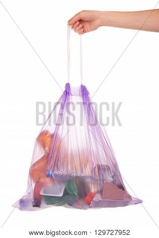Full garbage bag with drawstring keeps the hand isolated on white background