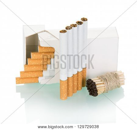 pack of cigarettes and associated matches isolated on white background