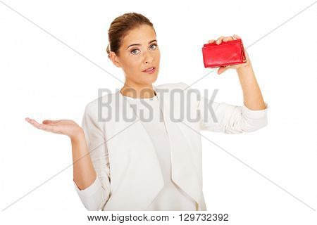 Shocked businesswoman looking into her empty wallet
