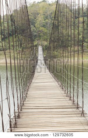 Suspension rope bridge above the lake path way to forest at Kaeng Krachan national park in Phetchaburi Thailand