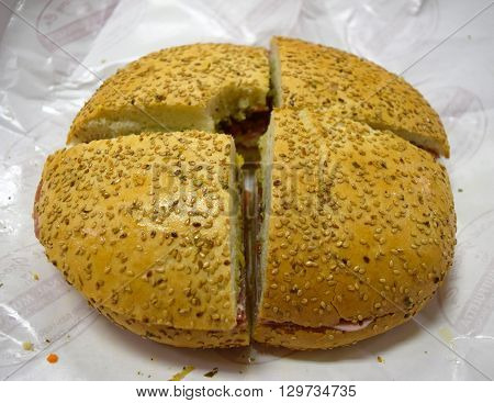 Photograph of a delicious traditional muffuletta sandwich.