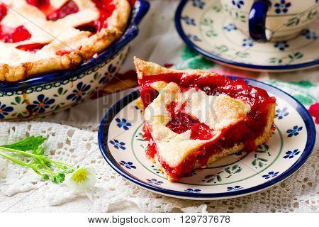 Strawberry lattice  pie. Style vintage. Selective focus.