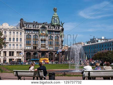 St. Petersburg Russia - May 8 2016: -Singer- of the company's famous home. Now the bookstore is located in the building -House of Books-. View from the square in front of the Kazan Cathedral. In the foreground fountain.