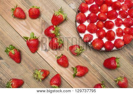 strawberry tart , strawberry shortcake , strawberry jam, on the table